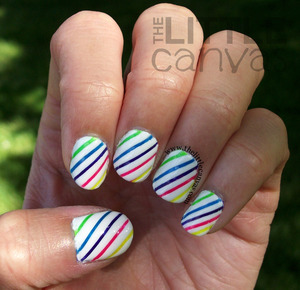 http://www.thelittlecanvas.com/2013/07/fruit-stripes-tape-manicure.html