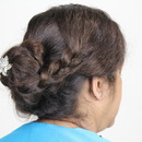 Messy coiled updo with Side Braid