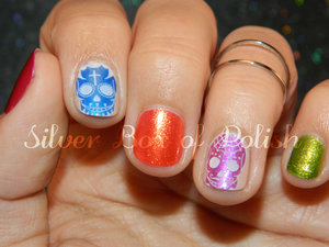 Colorful nails created with reverse stamping.