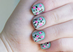 teal polish with neon pink dots and sticks/stones top coat