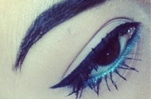 Used maybelline's eyeliner for the cat eye and maybelline's color tattoo in tenacious teal on the waterline ! It really makes brown eyes pop! And for mascara I used they're real by benefit and colossal cat eyes by maybelline :)