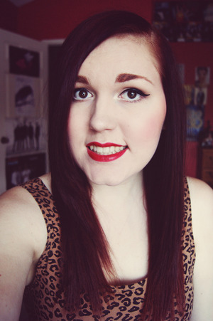 I got this red lipstick the other day and I am in love with it! It's Rimmel Moisture Renew in Diva Red!