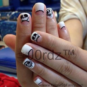 DETAILS HERE:  http://fingertipfancy.com/nightmare-christmas-nails