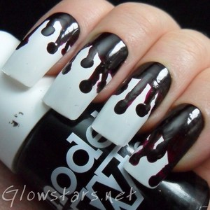 To find out more about this mani visit http://glowstars.net/lacquer-obsession/2012/10/dripping-blood