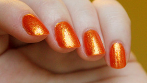 My new favorite polish ever!! Sparkle and Soar by Color Club is a glass-fleck lover's glass-fleck <3 Orange jelly base with yellow shimmer. Way more beautiful in person, it's crazy.
