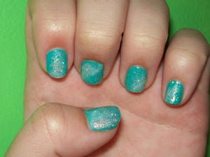 """I had soooo much fun doing this, and I couldn't stop looking at them, afterwards! Be warned! They're distracting! Base: dELiA*s nail polish- Pool Party Nail White """"clouds"""": Sally Hansen Hard as Nails Xtreme Wear- 300 White On Sparkles: Wet n Wild Wild Shine- 460D Kaleidoscope"""
