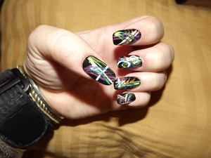 sin ful colors and wet and wild nail color combine for a outrageous design!