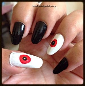Detail Tutorial http://lovefornailpolish.com/easy-diy-halloween-nail-art-how-to-make-vampire-eyes