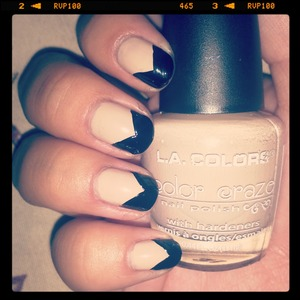instead of the regular french tip i did a bold black chevron tip with a beige base! :)