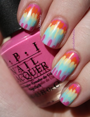 I painted streaks onto my nails in rainbow order, leaving space between them to show the previous colors.