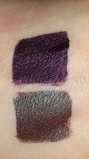 La Splash day of the dead liqued lipstick swatches. Top is Hasta La Muerte and bottom is Catrina
