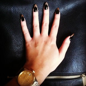 Black nails with gold tips. I used ciate chalkboard paint pot an elf gold nail polish, and just an NYC brand top coat to add shine