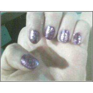 Purple pure ice nail polish and wet and wild's purple glitter polish