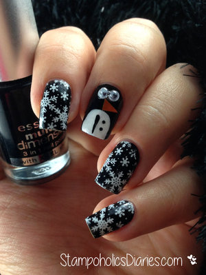 http://stampoholicsdiaries.com/2014/12/21/penguin-nail-design-with-essence-and-born-pretty/