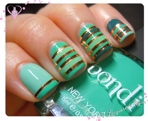 A striping tape mani with the greens from Bondi New York, a new nail polish brand in town. More review and swatches on http://www.alacqueredaffair.com/Bondi-Teal-Magnolia-company-29352083