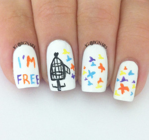 A very personal manicure with written words and birds flying out from a cage.