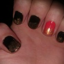Black with coral accent nail and gold glitter