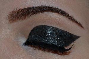 Sleek, black glitter eyes.