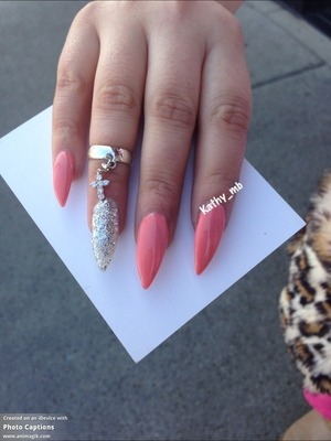 Stiletto nails with light pink and silver