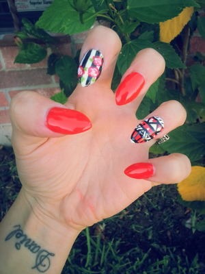 red, tribal striped red flowers polished and uv coat on top of acrylic stiletto nails