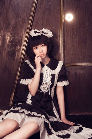 Taken in China - Still Doll  Makeup = Brown eyeliner, false eyelash, eyelid tape, concealer, lip gloss (All Chinese brands)