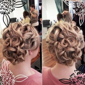 """I used Joico's Dry Shampoo (doesn't leave any white residue, and smells amazing!). And BioMega working-spray, curled in sections with a Hot Tools 1"""" curling iron.  Pinned up, Finished with Kenra's #25 hair spray, and Kenra's Shine spray."""
