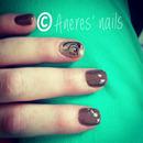 Brown Gel Nails With A Printed Nail Art
