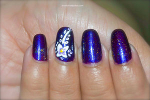 For more details visit http://lovefornailpolish.com/purple-and-white-flower-nail-art-pretty-floral-design