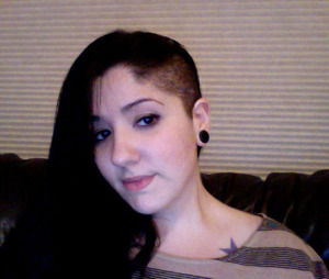 went crazy one day and shaved the side of my head! i LOVE this look!! my mother wouldn't talk to be for the next few days after (im 25 mind you lol) but she makes me bows n things now to show it off. =)