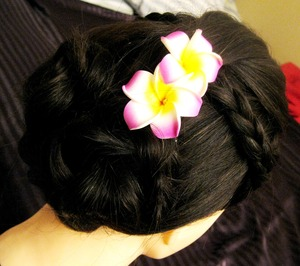 Here's a very quick and easy updo that doesn't require heat...that is perfect for summer!