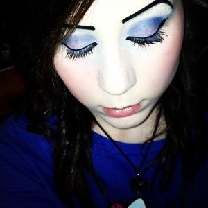 Blue and purple smokey eyes with winged eyeliner.