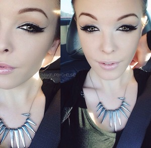 Dramatic eyeliner and a nude lip