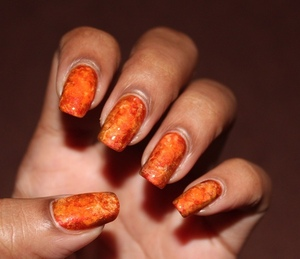Day 2 of the 31day nail challenge: Orange Watercoloured Nails using Orly Flicker, Santee Neon Orange and China Glaze Orange you Hot? http://www.bellezzabee.com/2012/09/nail-challenge-day-2-orange-nails.html