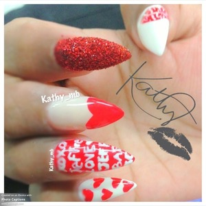 Stiletto nails with nude color and red heart , glitter