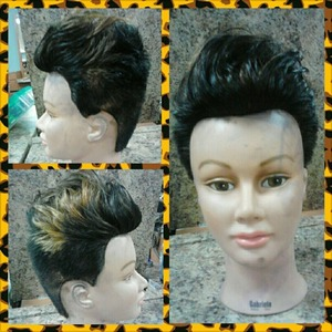 short hairstyle, a scissor over comb fade with volumized hair style.