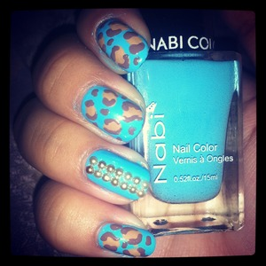 baby blue nails with neutral leopard print and bronze rhinestones on accent nail :)