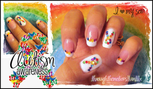 Base: China Glaze .:. White On White Colors used for dotting: Maybelline .:. Crimson, Avon .:. Vivid Violet, Sally Hansen .:. Mellow Yellow, Sinful Colors .:. Cloud 9, Sinful Colors .:. Hot Spot, Love & Beauty .:. Sky Blue