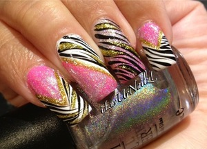 On my natural nails except my pinky witch is acrylic cause it broke :-(  The colors i used are Essie Blanc and Sallys Xtreme Wear Pretty In Hot Pink I topped it off with Spectra Flair I used Acrylic Black Paint to make my zeba print and Kiss Nail Art Striper in Gold