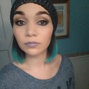 Neutral eyes with a pop of blue and grey/lavender lips.