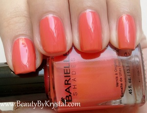 "Barielle describes Gotta Have Fate as ""opaque creamy coral"", and it is definitely an opaque polish. These photos show two coats with a base and top coat, but I have worn this with one generous coat and didn't have any balding or streaking - it's a gorgeous formula. The color is very rich, it's a beautiful orange-coral. It's very wearable since it has a soft creme finish, it's a nice change from all the Summer brights going around lately. My favorite use for this color - pedicures! It makes my little feetsies look so tan and beautiful!"