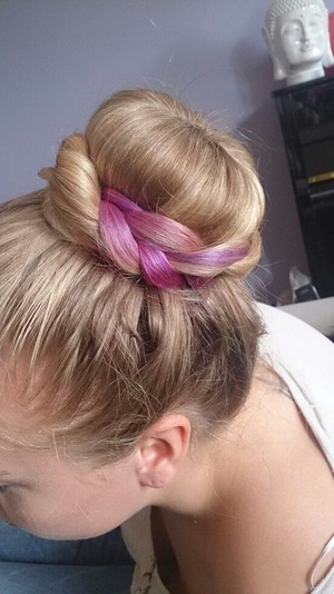 it looks so cute to put a donut + braid in your hair when you have a colorful dip dye,