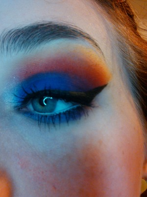 purple and dark blue mixed on lid, red orange to yellow faded