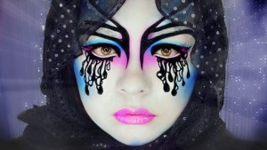 Makeup of the Zodiac is a monthly makeup series where I visualize how each sign would look like if brought to life.  This look is for Aquarius.  I used Mehron Clown White as the base and used exclusively Sugarpill eyeshadows.  Over the black I used Wolfe FX Paint in Black and for my lips I used OCC Lip Tar in Hoochie, which I suspect is expired or something because it looks bright pink but it's supposed to be purple o_O Wut.  To see the video of this transformation, click here: http://youtu.be/us7QKNSUSnc