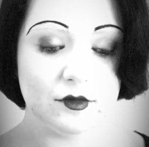 In the Diploma Of Screen And Media we had to recreate the popular makeup style worn by women in the 1920's, this is my recreation of a 1920's makeup that was popular for women at the time.