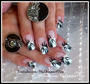 BLACK AND WHITE ABSTRACT NAIL ART DESIGN TUTORIAL. https://www.youtube.com/watch?v=_g8Hrao4RoM