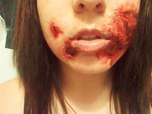 liquid latex. gel blood. black paint makeup. patience. love it. ask for tips.