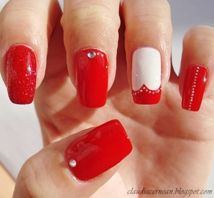 Tutorial on : http://claudiacernean.blogspot.ro/2013/01/unghii-rosii-cu-inima-red-heart-nails.html