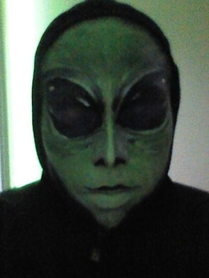 Alien Halloween makeup - Fairly simple.  Green face, bold eyes.  Facial shading with black kohl, black eye shadow and black face paint. mouth and nostrils done in liquid liner. White used to highlight