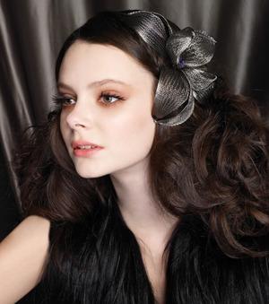 curly hair, hair accessory, nude lip, brown eyeshadow