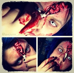 Really quick easy makeup look! I used: -Scar/Nose Wax -Fake Brain -Spirit gum -Fake Blood -Bruised color wheel